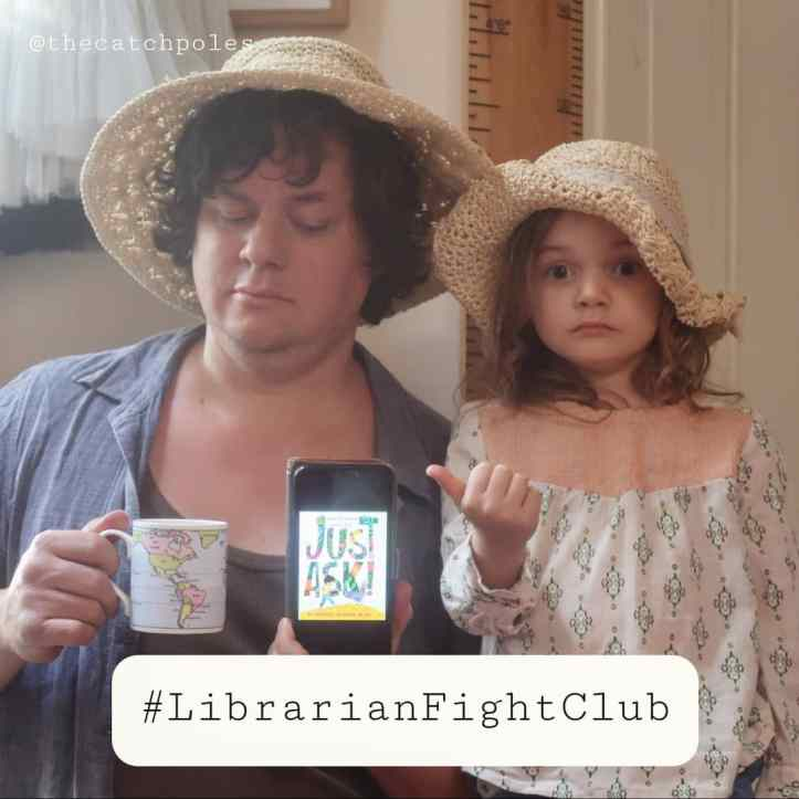 """James is holding his phone, which is showing the cover of Just Ask! - a children's picture book. James is looking askance at it and Mainie's looking straight at the camera with a startled """"nope"""" expression on her face. They're both wearing straw hats, which are not relevant. (But lovely IMO.)"""