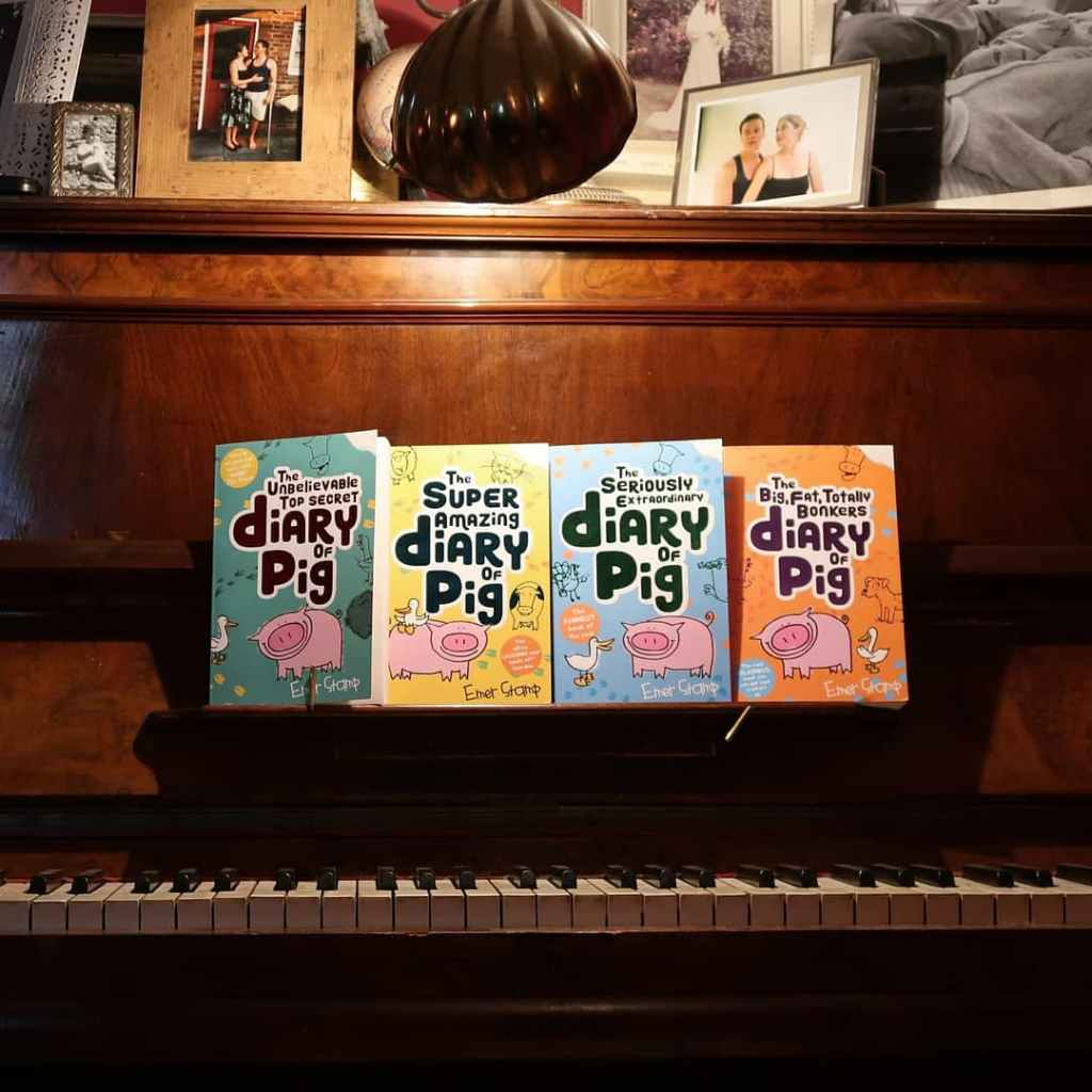 All 4 Diary of Pig books, lined up on our piano.
